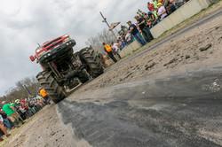 Monster truck drives on dirt road