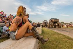 Girls looking at monster trucks