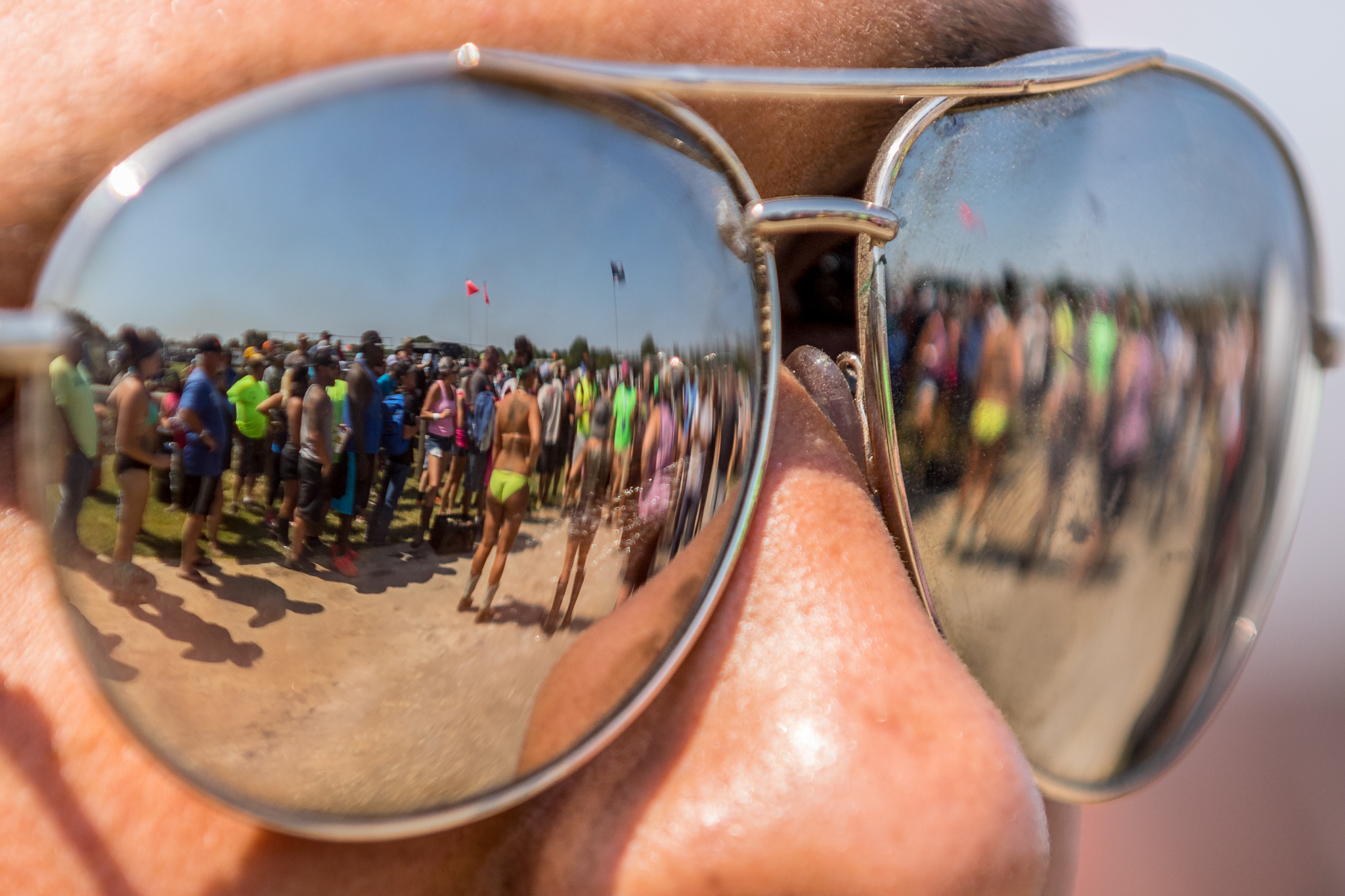 Sunglasses with reflection of people