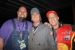 Three friends smile at camera