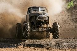 Monster truck on dirt ramp