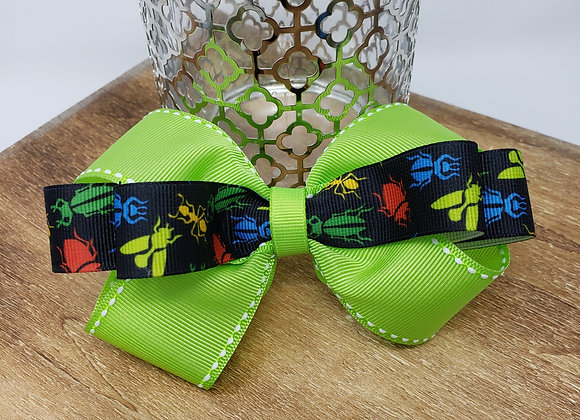 Bugging on green Boutique Bow