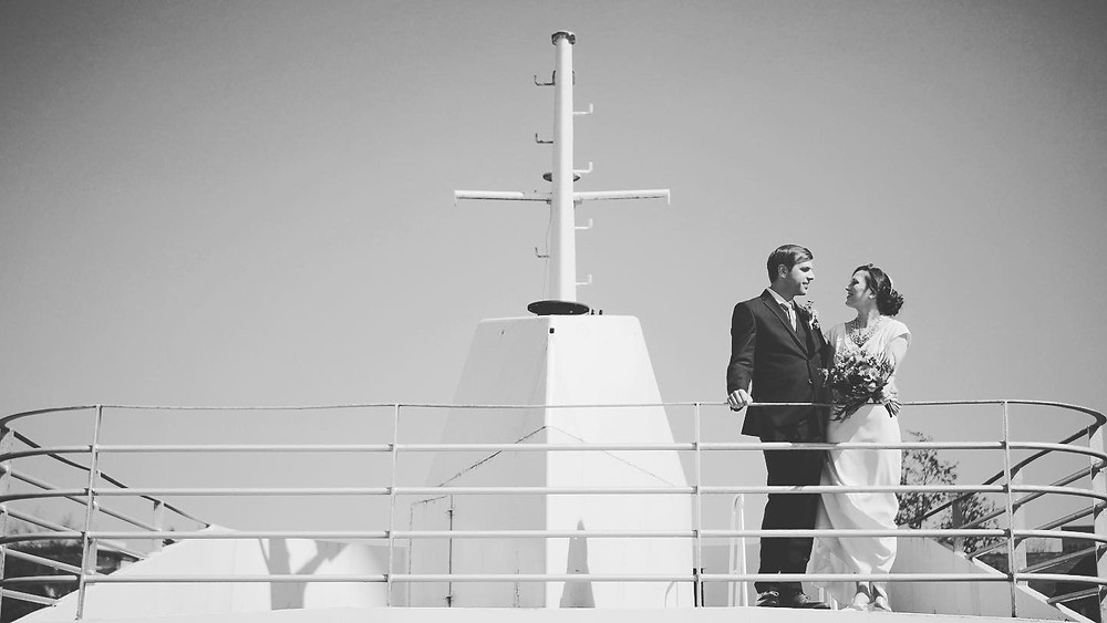 bride & groom at front of yacht