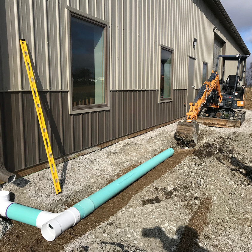 2017_11_16 Installing drains on east side of building