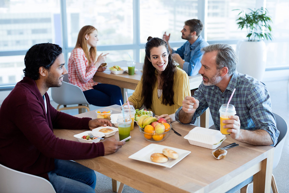 Employees enjoying lunch hours at workplace