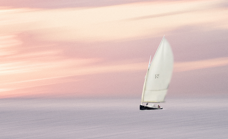 Yacht and Sureal Sky and Sea.