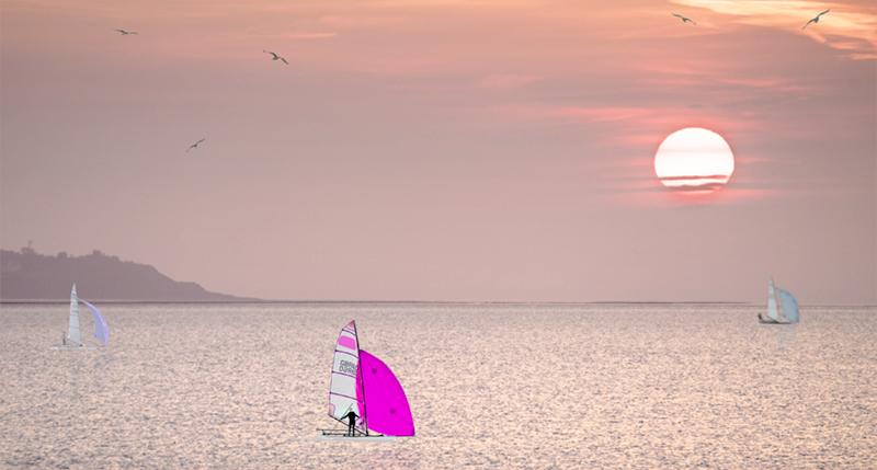 Skiffs Racing into the Sunset.