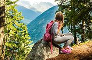 Cute little girl hiking in swiss Alps, r