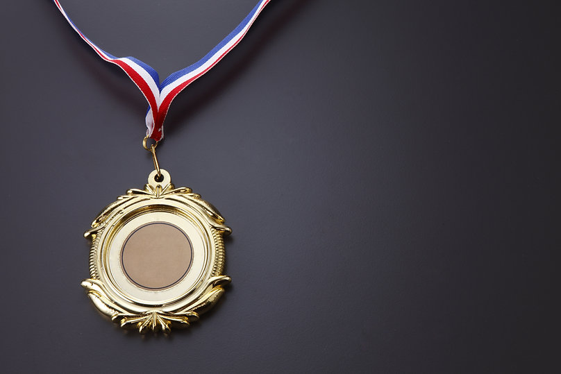 Gold medal isolated on the background..j