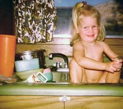 Jenny taking a bath in the sink