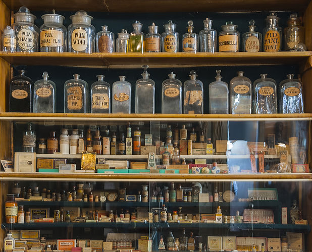 Empty scent bottles in old pharmacy.jpg