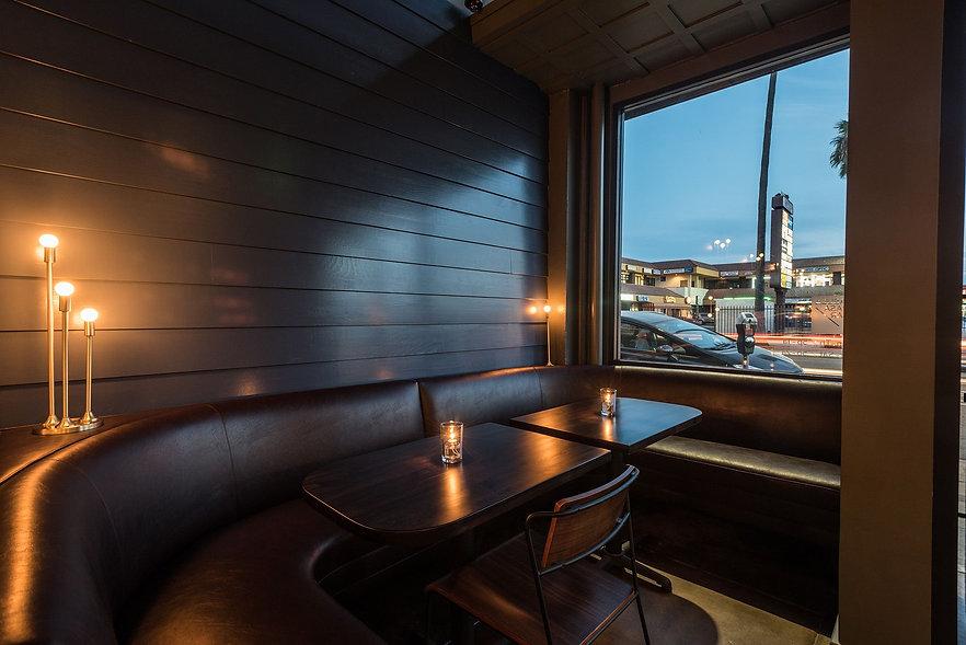 booth and light fixture facing hollywood at Tabula Rasa by Ricki Kline