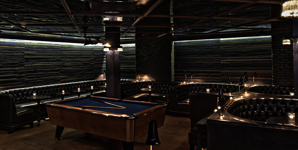 Seven Grand Four Ways Whiskey Bar Design Photo with chalkboard and hand mand lamps.