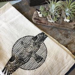 Tea towels and driftwood arrangements fo