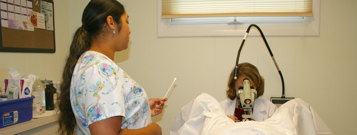 Dr. Choma at work performing a colposcopy.