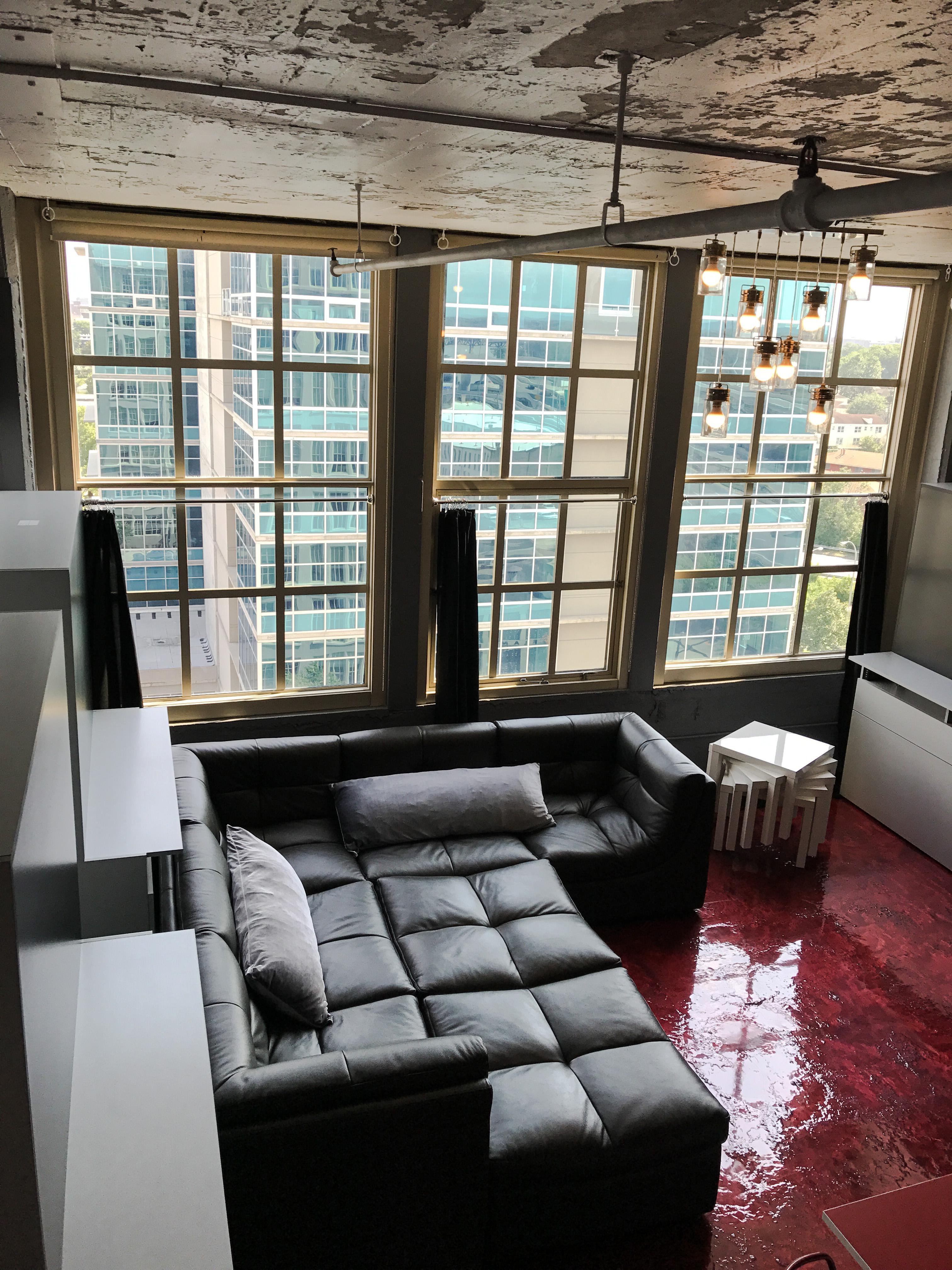 Loft Reverie Hotel 708 - Birdseye Views + Cloud Sofa + Living Area