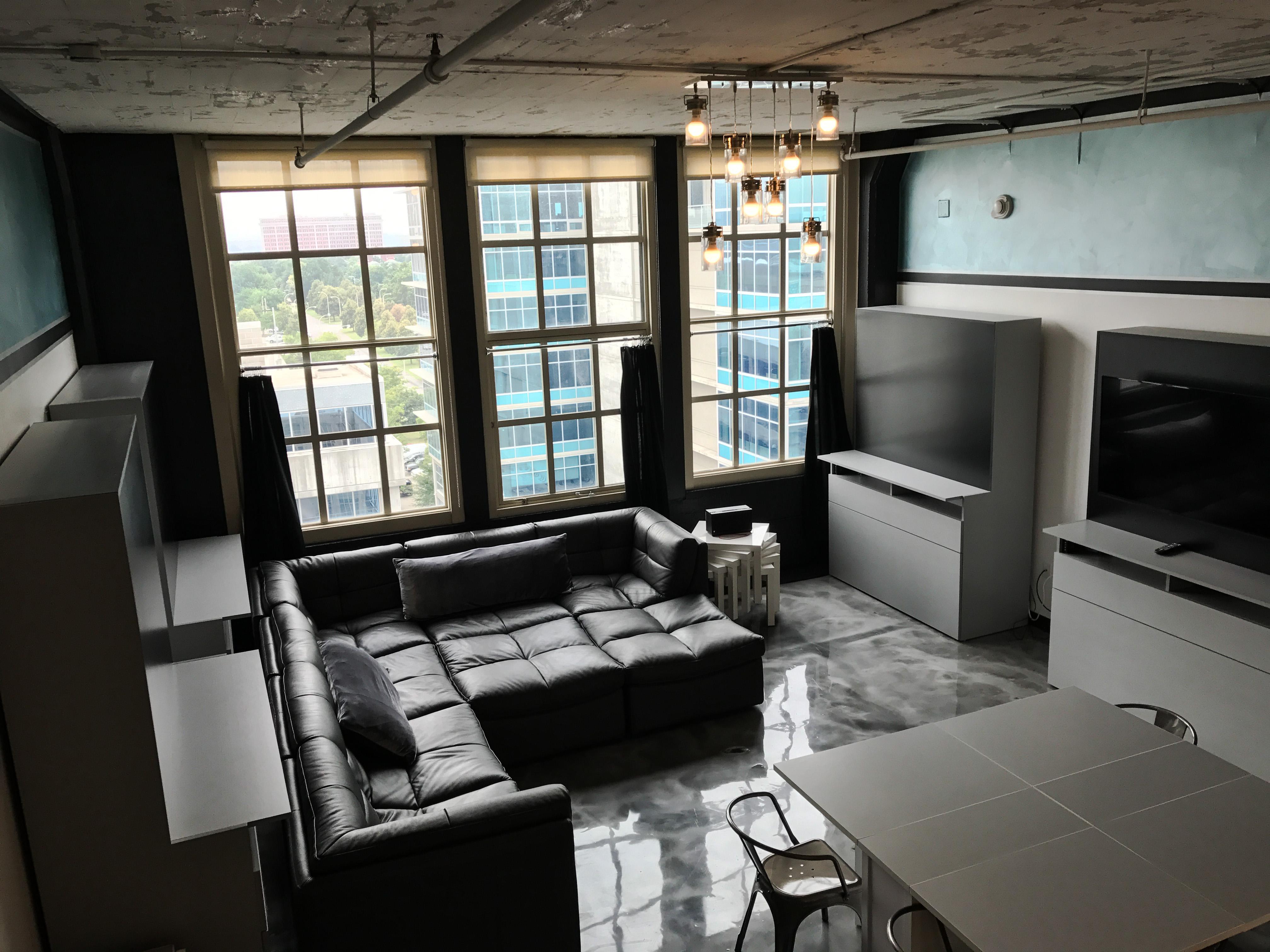 Loft Reverie Hotel - Loft 711 - Birdseye Living Area + Cloud Sofa