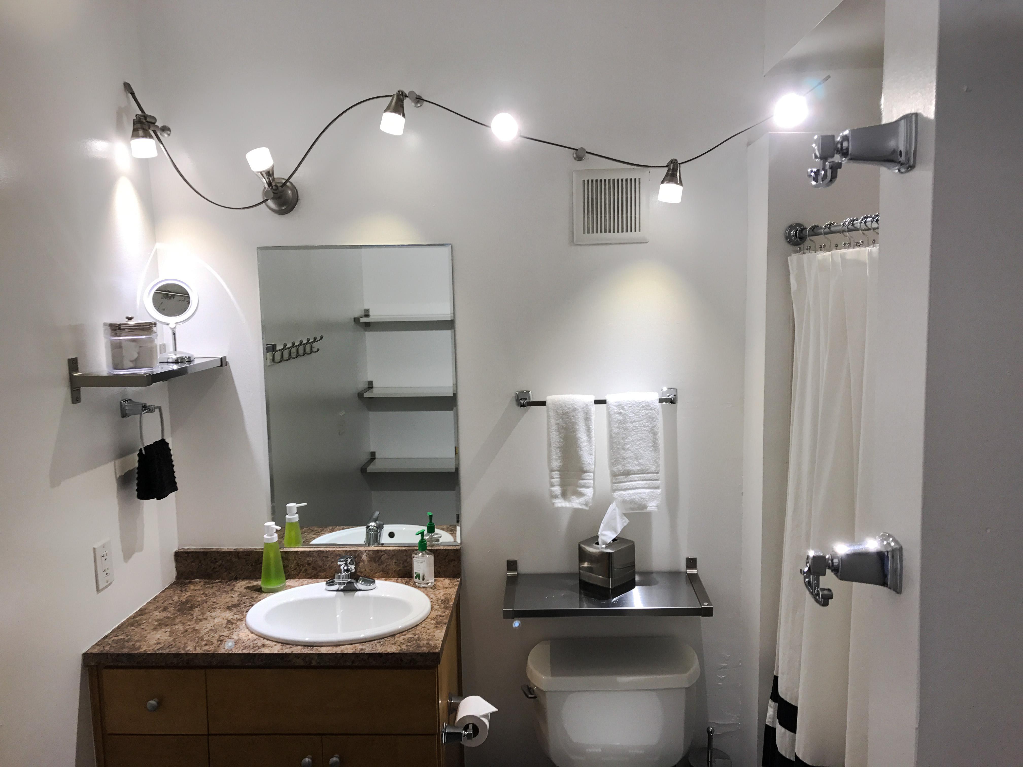 Loft Reverie Hotel 703 - Bathroom + Amenities + Lighting + Vanity Mirror + Shower + Soaps + Towels +