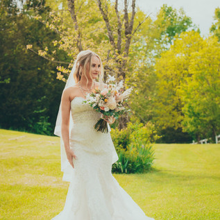 Bride standing in the meadow