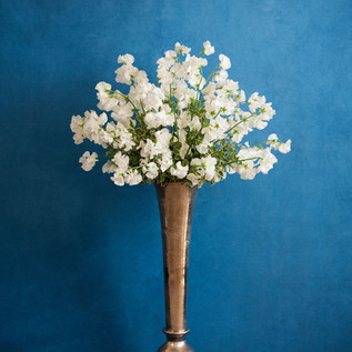 Large vase of sweet peas