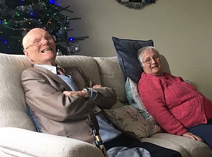 Old people in a care home enjoy nostalgic songs and piano music.