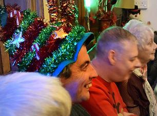 Learning disability group enjoys listening to Christmas Carols