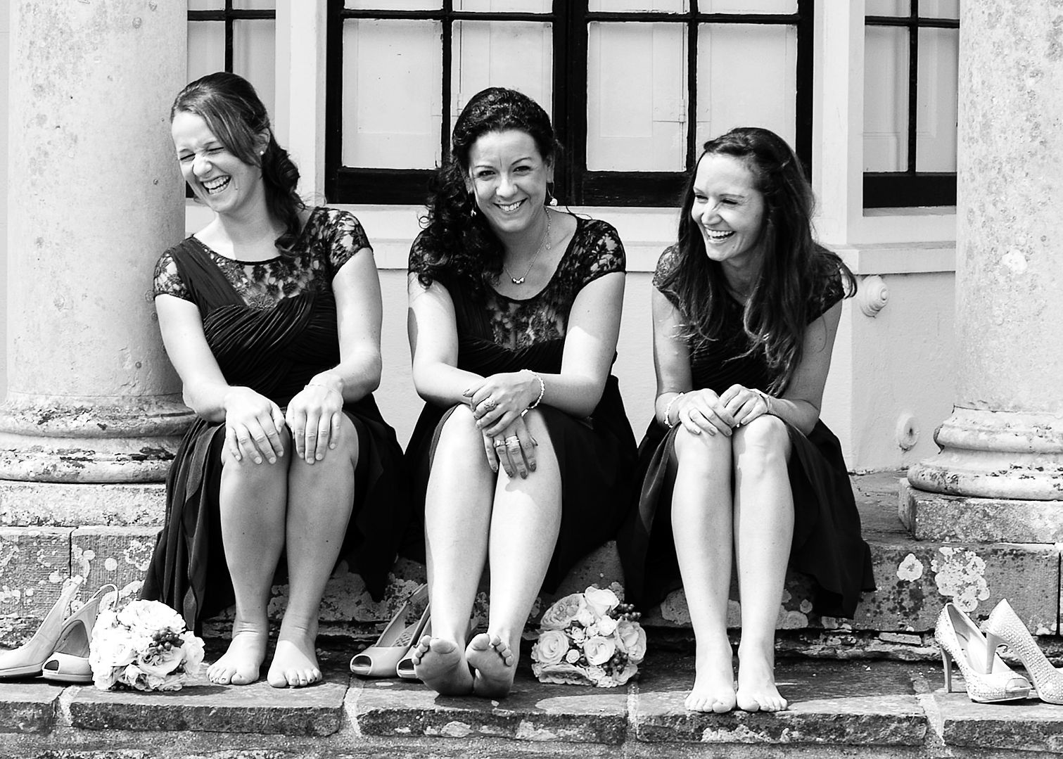 Bridesmaids under the arches at Hendall Manor