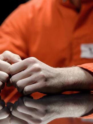 Arrested person hands closeup, prisoner