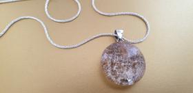 Collier cristal de roche et argent. Atelier Sôma. Outils de lithothérapie, bijoux made in france fabriqués à la main.