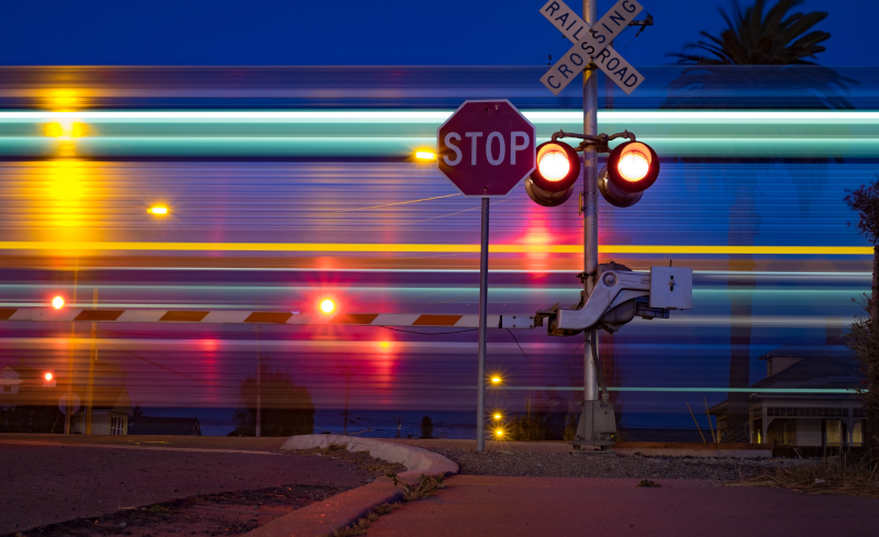 speeding train and stop sign