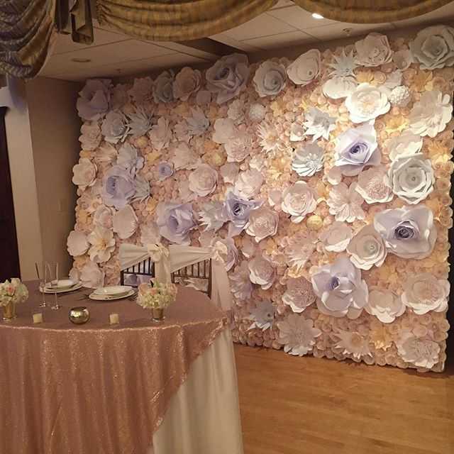 Todays backdrop at the Winter Bridal Show at Cascade #nofilter #floralbackdrop #paperflowers #adorop