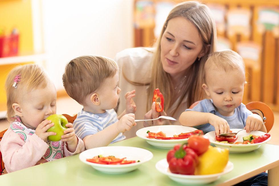 teacher and preschooler kids having brea