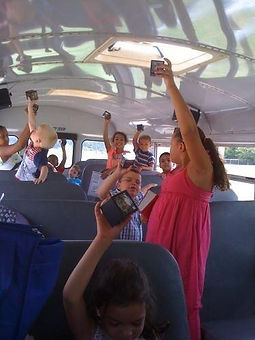 Kid's on a curch bus holding Message Boxes