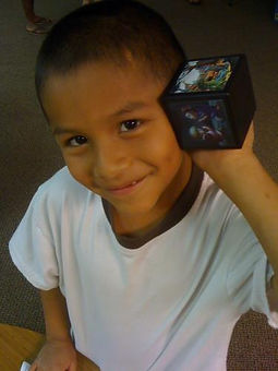 Little boy smiling with Spanish Message Box in Brazil