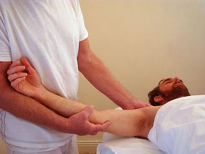 holding man's arm