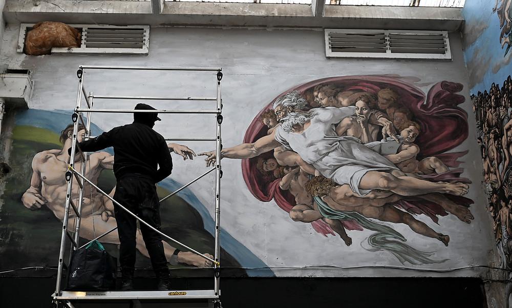 Pascal Boyart aka Pboy painting the Underground Sistine Chapel on a scaffold. Photo by @Stefano Rellandini
