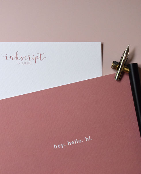hey hello hi dusky pink card with inkscript studio logo on the back with a Tom's Studio calligraphy pen and nib on top