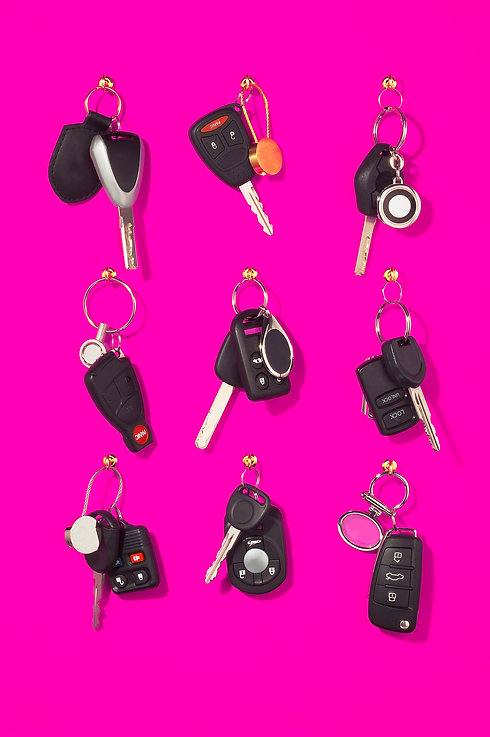 Hanging car keys on pink background.jpg