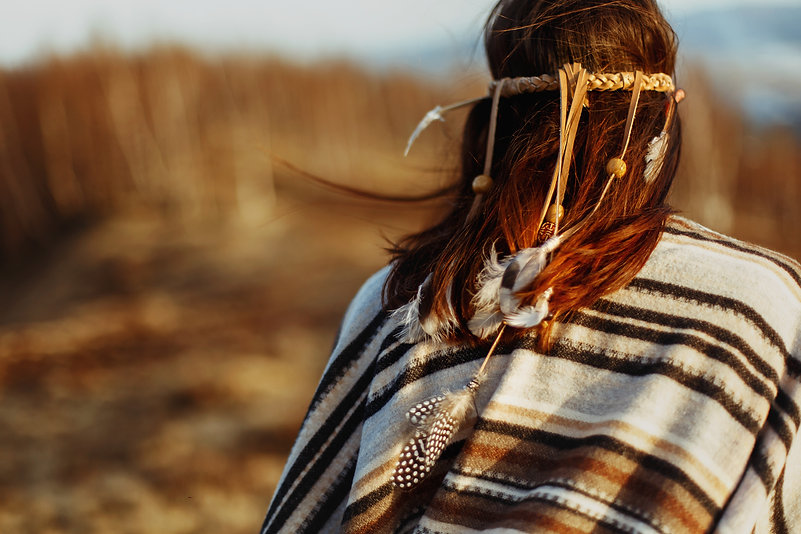 Image of the back of woman wearing Indigenous clothing