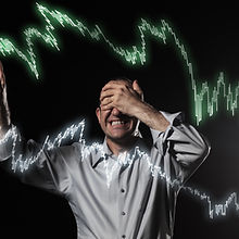 Scared trader pointing to stock market c