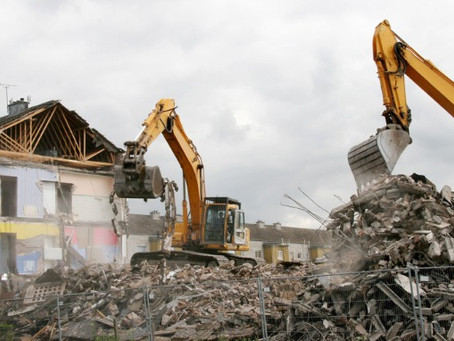When Should I Tear Down My House or Commercial Building?