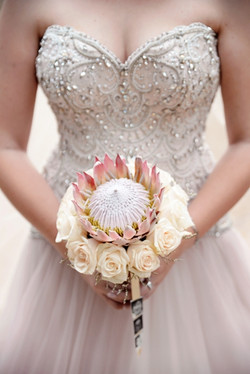 A king protea and rose bouquet