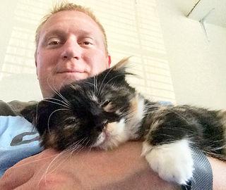 Foster dad with kitten