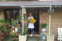 Anna outside Anna's Flower Barn