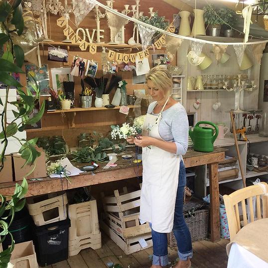 Anna working in Anna's Flower Barn