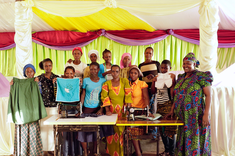 KiliTech sewing group posing with the Maua decorations