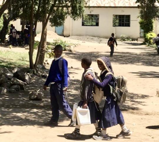 Girls at Seliani carrying water