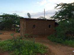 Satellite dish on a mud hut