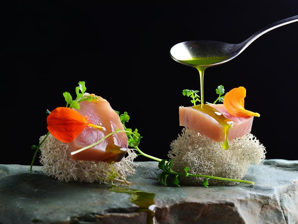 Fine dining, fresh raw ahi tuna sashimi served on sponge with herbs.jpg