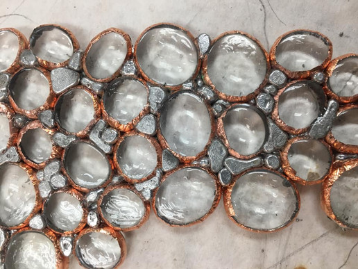 close up of cooper wrapped baubles